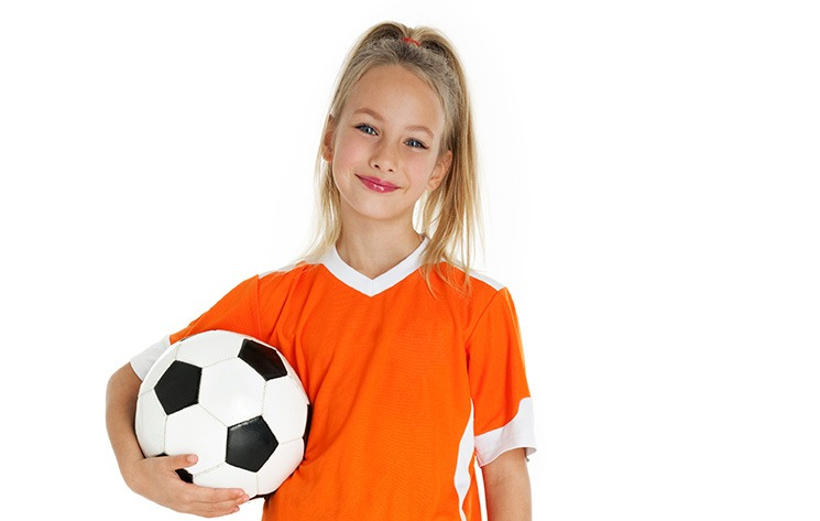 sports girl with soccer ball